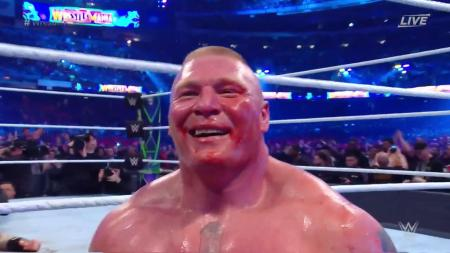 Brock Lesnar smiling after defeating Roman Reigns (Photo by the WWE)
