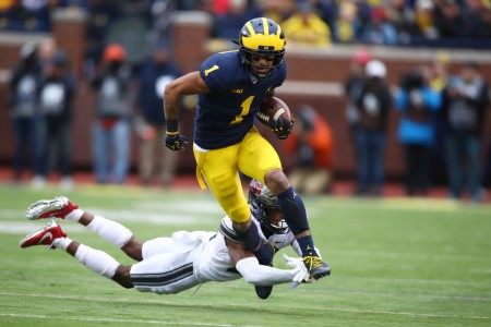 Former Ohio State Buckeyes corner Denzel Ward attempts to tackle Michigan Wolverines player Kekoa Crawford (Getty Images)