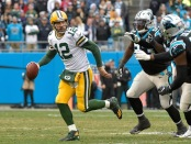 Aaron Rodgers attempting to escape the Carolina Panthers defense (Getty Images)