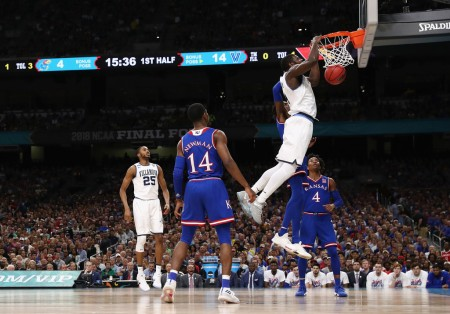 Villanova Wildcats player Eric Paschall is seen here dunking against the Kansas Jayhawks in the first half of their Final Four game (Getty Images)