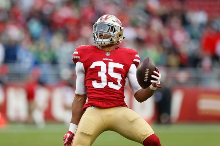 Former San Francisco 49ers safety Eric Reid celebrates an interception against the Seattle Seahawks