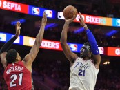 Miami Heat big man Hassan Whiteside attempts to block Philadelphia 76ers center Joel Embiid (Getty Images)