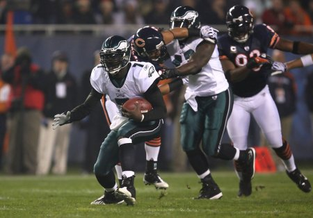 Michael Vick is seen here rushing the ball for the Philadelphia Eagles against the Chicago Bears in 2009 (Getty Images)