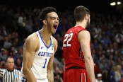 Sacha Killeya-Jones is seen here as a member of the Kentucky Wildcats celebrating a dunk against the Davidson Wildcats in the NCAA Tournament (Getty Images)