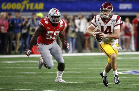 Sam Darnold is seen here attempting to break away from an Ohio State Buckeyes defender (Getty Images)
