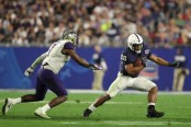 Saquon Barkley is seen here playing against the Washington Huskies in the PlayStation Fiesta Bowl (Getty Images)