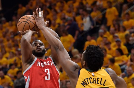 Chris Paul taking a photo over Donovan Mitchell (Getty Images)