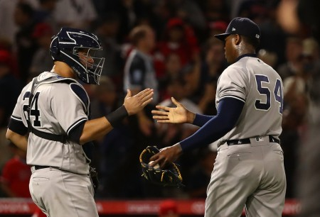 Gary Sanchez celebrates a Yankees win with closer Aroldis Chapman (Getty Images)