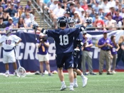 Jack Tigh celebrates a Yale Bulldogs score on Saturday (Photo by the NCAA)