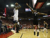 Jamal Crawford attempting to make a shot over Houston Rockets forward P.J. Tucker (Getty Images)