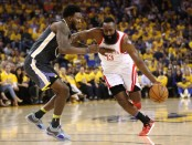 Rockets star James Harden is guarded by Golden State Warriors' Jordan Bell (Getty Images)
