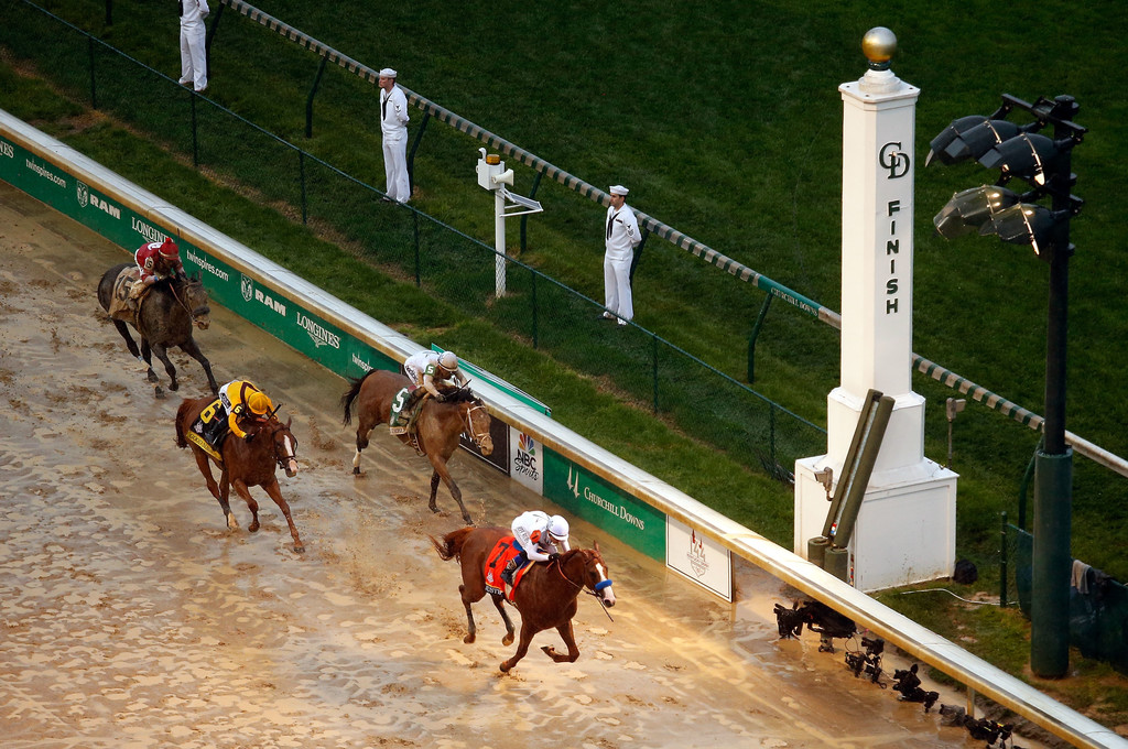 Justify crosses the finish line to win the 144th running of the Kentucky Derby at Churchill Downs