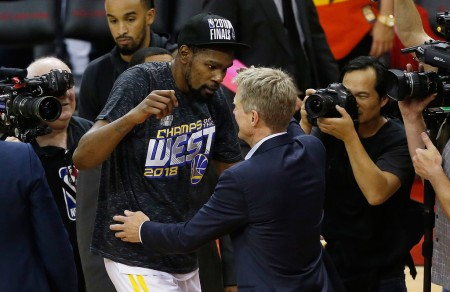 Kevin Durant hugs head coach Steve Kerr after the Warriors defeated the Rockets on Monday night (Getty Images)