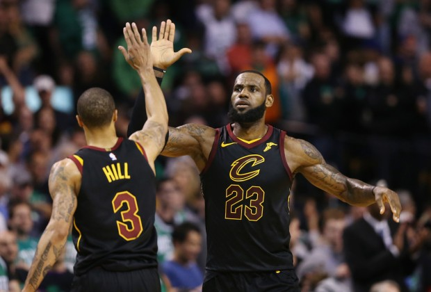 Cleveland Cavaliers star LeBron James celebrates with George Hill in the second half in Game 7 against the Boston Celtics of the Eastern Conference Finals