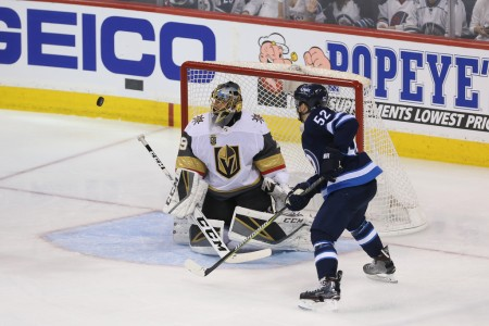 Vegas Golden Knights goalie Marc-Andre Fleury attempts to make a save as Jack Roslovic looks on