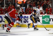 Marián Hossa attempts to get the puck from Nashville Predators Kevin Fiala (Getty Images)