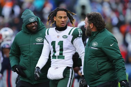 Robby Anderson is seen here walking off the field after suffering an injury against the New England Patriots in the season finale in January (Getty Images)