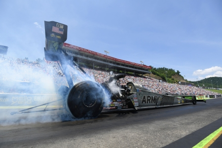 Tony Schumacher doing a burn out in Bristol (Photo by the NHRA)