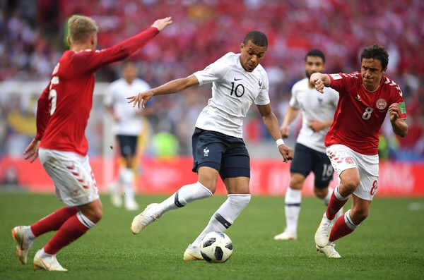 Kylian Mbappé challenges Denmark's Thomas Delaney in World Cup Group C action (Getty Images)