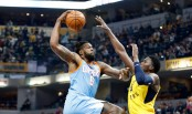 Los Angeles Clippers center DeAndre Jordan attempts to dunk on Indiana Pacers star Victor Oladipo (Getty Images)