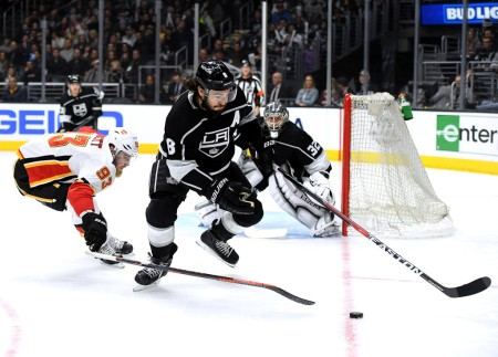 Drew Doughty attempts to get the puck against the Calgary Flames (Getty Images)