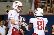 Tyler Hilinski celebrates with his former teammate Renard Bell during a touchdown against the Arizona Wildcats in October 2017 (Getty Images)