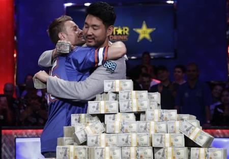 Todd Miles hugs first place winner John Cynn after Cynn won the grand prize (Photo by the Associated Press)
