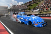John Force racing on Sunday at the mountain at Bandimere Speedway (Photo by the NHRA)