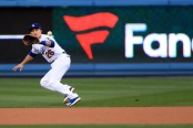 Chase Utley fielding a ground ball with the Dodgers (Getty Images)