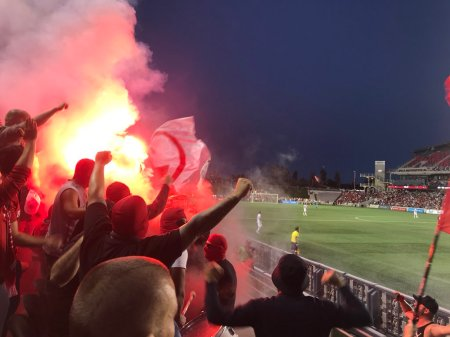 Fire services were called to the Ottawa Fury's TD Place after Toronto FC fans let off flares that caused a small blaze. (Martyn Bailey/@martyn_bailey)