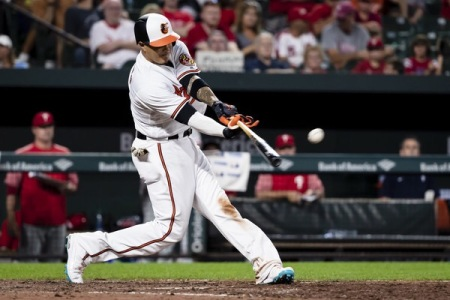 Manny Machado hitting the ball against the Philadelphia Phillies (Getty Images)