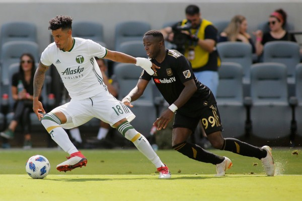 LAFC's Adama Diomandé looks to get control of the ball against Portland Timbers' Julio Cascante (Getty Images)