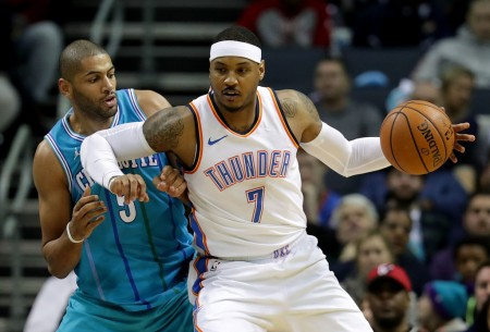 Former Thunder forward Carmelo Anthony is seen here posting up Charlotte Hornets' Nicolas Batum (Getty Images)