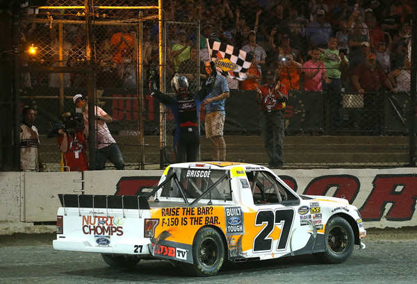 Driver Chase Briscoe celebrates with the checkered flag after winning the NASCAR Camping World Truck Series Eldora Dirt Derby