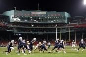 David Pindell hands the ball off to Kevin Mensah against the Boston College Eagles at Fenway Park (Getty Images)
