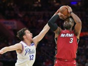 Dwyane Wade attempts a jump shot over Philadelphia 76ers' T.J. McConnell (Getty Images)
