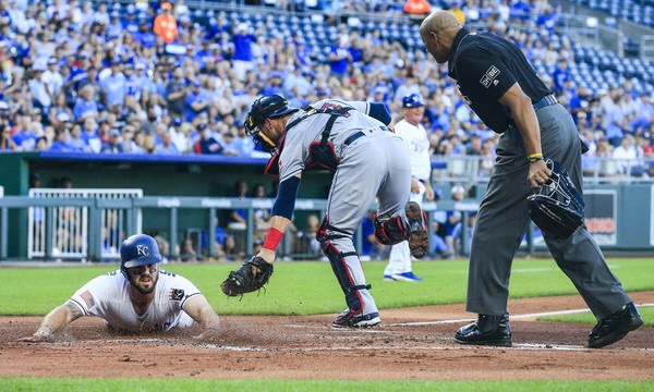 Mike Moustakas attempting to score against the Cleveland Indians (Getty Images)