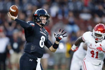 Hayden Moore throwing a pass against the Houston Cougars (Getty Images)