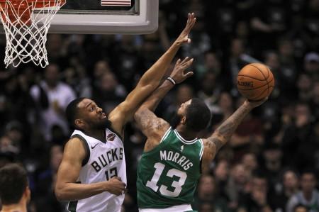 Former Milwaukee Bucks forward Jabari Parker attempts to make a block