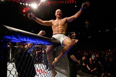 Junior Dos Santos is seen defeating Ben Rothwell