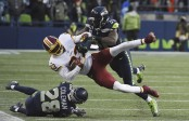Seattle Seahawks safety Kam Chancellor hitting Washington Redskins wide receiver Brian Quick (Getty Images)