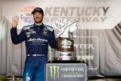 Martin Truex Jr. standing next to his Kentucky Speedway trophy (Getty Images)