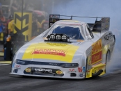 Funny Car pilot Matt Hagan is making a pass under the Sandvik Coromant brand in Seattle