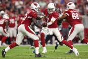 Arizona Cardinals running back Adrian Peterson attempts to rush the ball