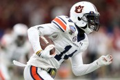 Former Auburn Tigers player Stephen Roberts runs with the ball against the Oklahoma Sooners
