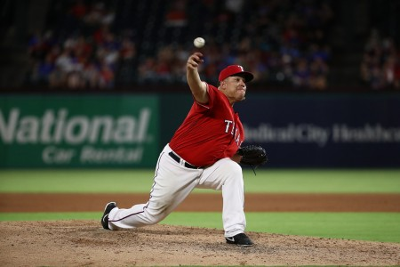 Bartolo Colón makes a pitch in an MLB game against the Mariners