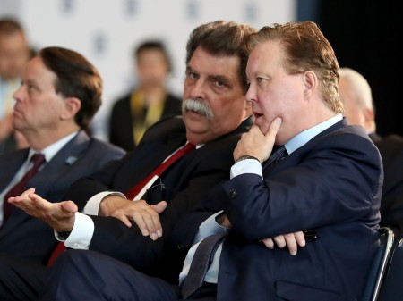 Brian France and Mike Helton talking during NASCAR Hall of Fame Voting Day