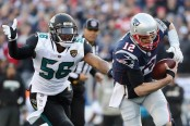 Dante Fowler attempts to make a play against Tom Brady