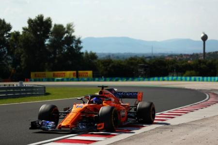 Fernando Alonso racing in a 2018 Formula One race