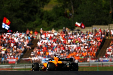 Fernando Alonso driving on a road course in Hungary